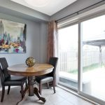 Image of the dining area overlooking the backyard in a glass sliding door at 6 Warner Lane