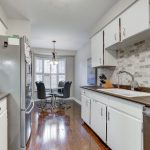 Image of the Kitchen with the complete furnishings and appliances inside the house at 60 Rawling Crescent