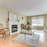 View of the furnished Living Room and fireplace inside the house at 42 Dragon Tree Crescent